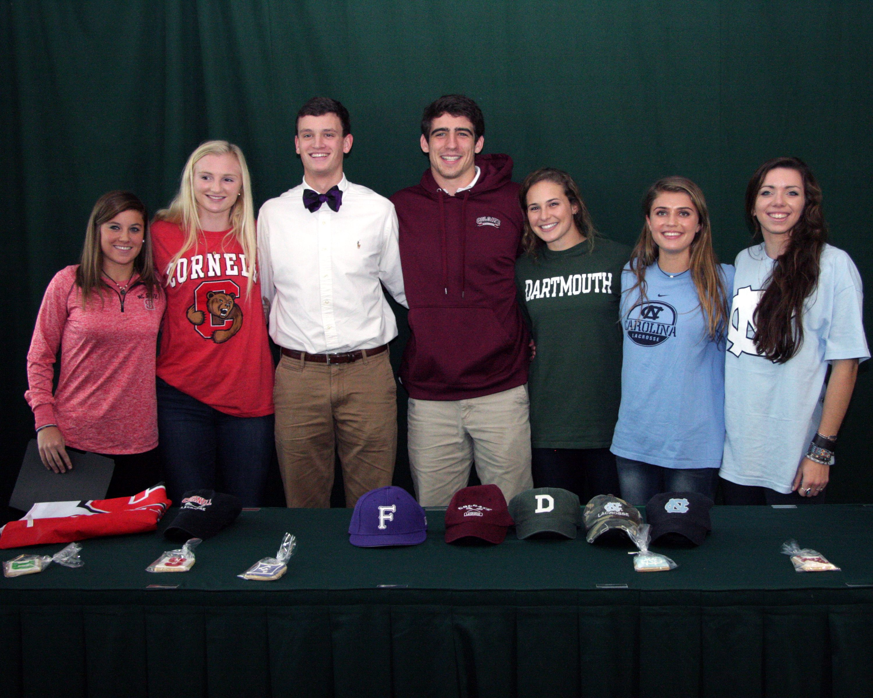 Seven Country Day seniors were formally recognized in a ceremony Monday for their commitments to play college sports at NCAA Division I schools.